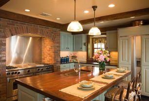 Traditional Kitchen with Kitchen island, Stainless Steel, full backsplash, Exposed beam, Hardwood floors, L-shaped, Casement