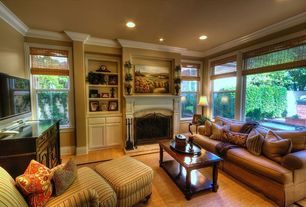Traditional Living Room with Crown molding, Paint 1, Cement fireplace, double-hung window, Standard height, Laminate floors