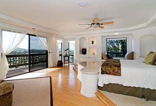 Contemporary Master Bedroom with Ceiling fan, High ceiling, Bamboo floors, Built-in bookshelf, flush light