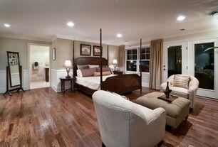 Traditional Guest Bedroom with interior wallpaper, Crown molding, Hardwood floors, French doors