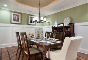 Modern Dining Room with Wainscotting, Chandelier, Wall sconce, Crown molding, Laminate floors, Chair rail