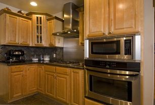 Traditional Kitchen with Large Ceramic Tile, Simple granite counters, Vinyl floors, L-shaped, Raised panel, Glass panel
