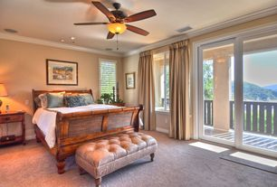 Mediterranean Guest Bedroom with Carpet, picture window, Standard height, can lights, Crown molding, sliding glass door