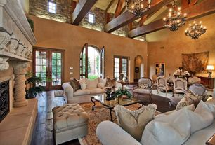 Craftsman Living Room with picture window, Exposed beam, French doors, stone fireplace, Hardwood floors, High ceiling