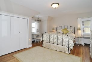 Cottage Guest Bedroom with Carpet, Chandelier, Hardwood floors, flush light, Wall sconce