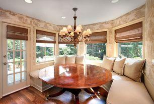 Traditional Dining Room with Window seat, Hardwood floors, Chandelier, Glass panel door