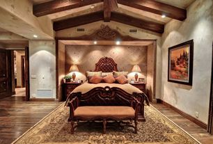 Traditional Master Bedroom with French doors, Hickory auburn spice 8 mm laminate wood look, Exposed beam, High ceiling