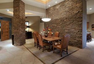Modern Dining Room with French doors, Pendant light, Columns, sandstone floors, Cathedral ceiling