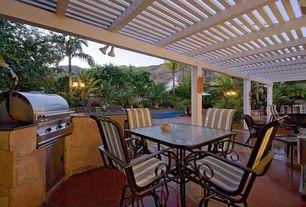 Tropical Patio with Trellis, Fence, exterior concrete tile floors, exterior tile floors, Outdoor kitchen