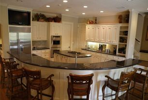 Traditional Kitchen with Double wall oven (stainless steel), L-shaped, Breakfast bar, Built-in bookshelf, Premium Black
