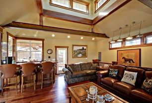 Country Living Room with Pendant light, Casement, French doors, can lights, High ceiling, Laminate floors
