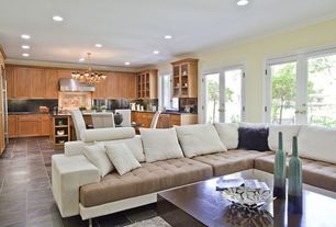 Contemporary Great Room with can lights, Standard height, Crown molding, French doors, Glass panel door, Concrete tile