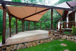 Craftsman Deck with Pathway, Glass panel door, exterior tile floors, exterior awning