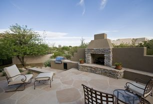 Rustic Patio with outdoor pizza oven, Outdoor kitchen, exterior stone floors, Fence
