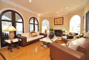 Eclectic Living Room with Laminate floors, Arched window, Cement fireplace, Crown molding