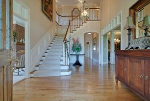 Traditional Staircase with Wainscotting, Hardwood floors, Crown molding, curved staircase, High ceiling, Balcony