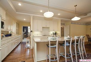 Country Kitchen with Pendant light, Stone Tile, Oak - saddle 3 1/4 in. solid hardwood plank, Kitchen island, Glass panel