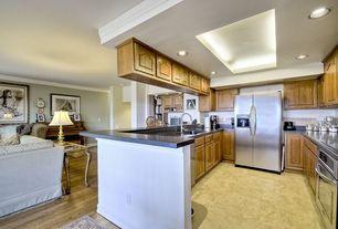 Traditional Kitchen with Skylight, Vinyl floors, Galley, KraftMaid Arch Raised Panel Honey Spice Oak Cabinets, Raised panel