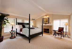 Traditional Guest Bedroom with Cathedral ceiling, Fireplace, Carpet, Casement, bedroom reading light, Crown molding