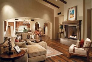 Mediterranean Living Room with Chandelier, Arched opening, Bellawood brazilian cherry, Hardwood floors, Exposed beam, Carpet