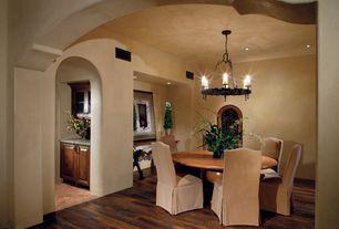 Mediterranean Dining Room with Hardwood floors