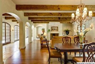Mediterranean Great Room with Wall sconce, Exposed beam, Columns, Chandelier, Hardwood floors, Arched window
