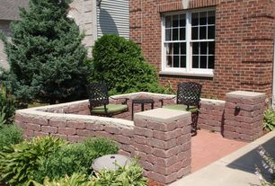 Traditional Patio with exterior brick floors, double-hung window