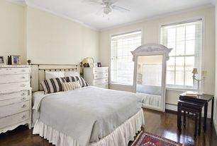 Eclectic Guest Bedroom with Hardwood floors, Carpet, Crown molding, Ceiling fan