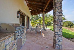 Craftsman Porch with Outdoor kitchen, exterior stone floors, Wrap around porch