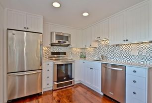 Traditional Kitchen with Framed Partial Panel, Flat panel cabinets, can lights, built-in microwave, L-shaped, Undermount sink