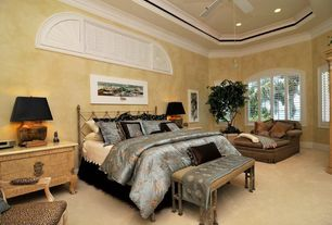 Eclectic Guest Bedroom with Ceiling fan, Carpet, Arched window, Crown molding