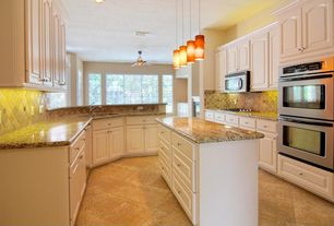 Traditional Kitchen with Ceiling fan, electric cooktop, Pendant light, Raised panel, Framed Partial Panel, full backsplash