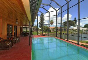 Country Swimming Pool with exterior concrete tile floors, French doors, Indoor pool, exterior tile floors, picture window