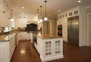 Traditional Kitchen with Custom hood, Built In Refrigerator, U-shaped, two dishwashers, Pendant light, Hardwood floors