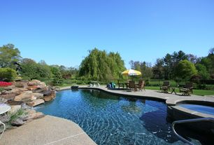 Rustic Swimming Pool with Infinity pool, exterior stone floors, Fence, Pool with hot tub