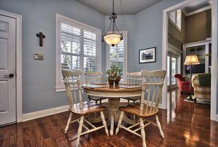Country Dining Room with Laminate floors, flush light, Hardwood floors, six panel door, High ceiling, Casement