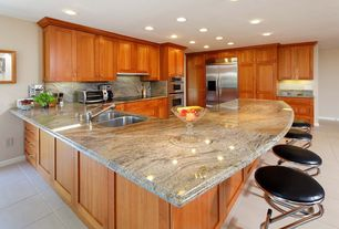 Craftsman Kitchen with Built-in bookshelf, Granite giallo alba polished, Custom hood, Flat panel cabinets, Complex Granite