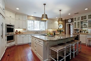Traditional Kitchen with Stone Tile, Simple granite counters, Hardwood floors, Crown molding, Wine refrigerator, Glass panel