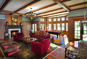 Traditional Great Room with stone fireplace, Hardwood floors, Exposed beam, Casement, French doors, Fireplace, Chandelier