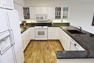 Traditional Kitchen with Hardwood floors, Simple granite counters, Built In Panel Ready Refrigerator, partial backsplash