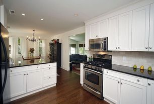 Traditional Kitchen with Chandelier, Soapstone counters, U-shaped, Stone Tile, Flat panel cabinets, Hardwood floors