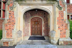 Traditional Front Door with exterior stone floors, Tudor arch enclosed entry, Pathway, English tudor wood door