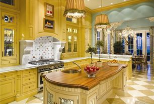 Traditional Kitchen with Kitchen island, Glass panel, Undermount sink, can lights, Custom hood, Crown molding, Breakfast nook