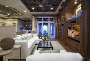 Traditional Living Room with sliding glass door, Transom window, Standard height, Laminate floors, Carpet, Ceiling fan