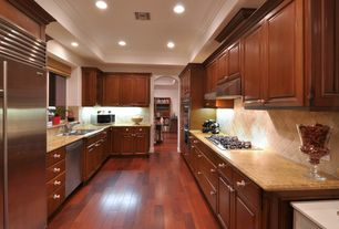 Traditional Kitchen with Laminate floors, Simple granite counters, Raised panel, Galley, Stone Tile, Undermount sink