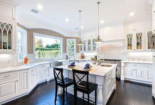 Traditional Kitchen with Laminate floors, Calacatta carrara, full backsplash, can lights, U-shaped, Framed Partial Panel