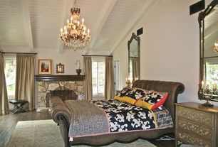 Eclectic Master Bedroom with Hardwood floors, stone fireplace, Exposed beam, Chandelier