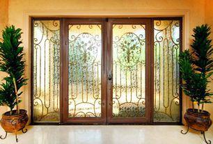 Mediterranean Front Door with Standard height, stone tile floors, French doors