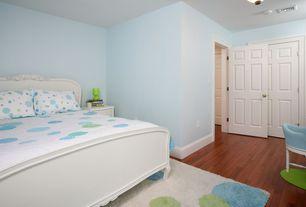 Modern Guest Bedroom with Pendant light, Carpet, Bamboo floors