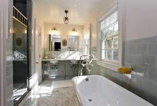 Traditional Full Bathroom with The builder depot carrara herringbone marble tile, Double sink, Console sink, Freestanding